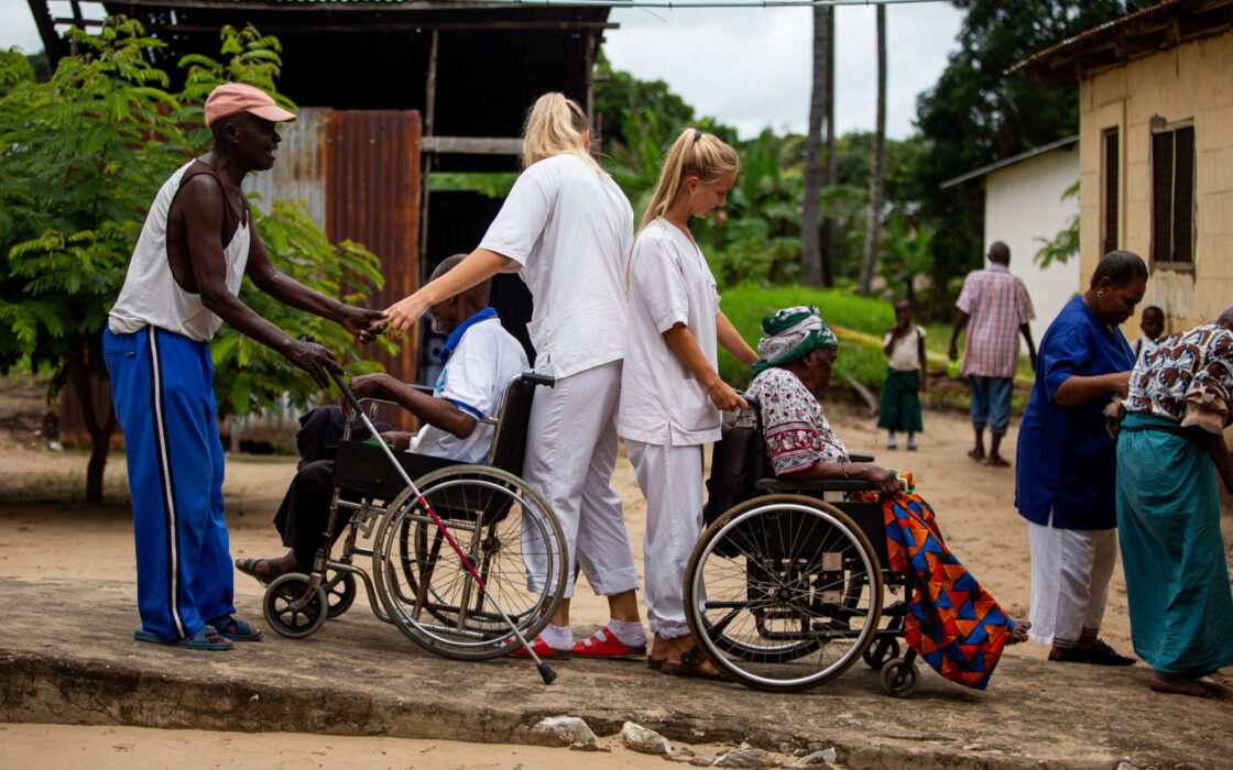 Two students guiding the elders back to their housing