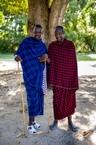 Portrait of two of the Maasai at TICC wearing their traditional attire