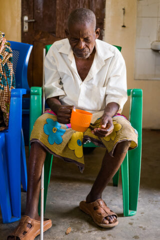 Elderly man with a cup of tea