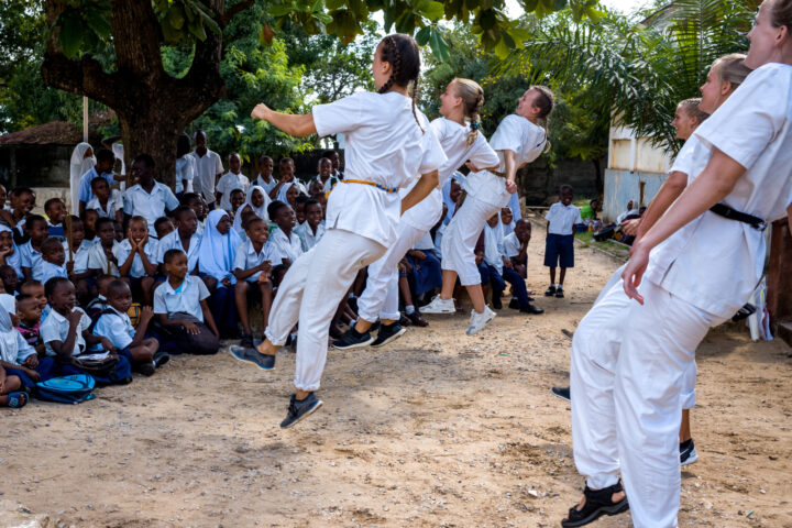 Students mid-air during their performance of a campaign