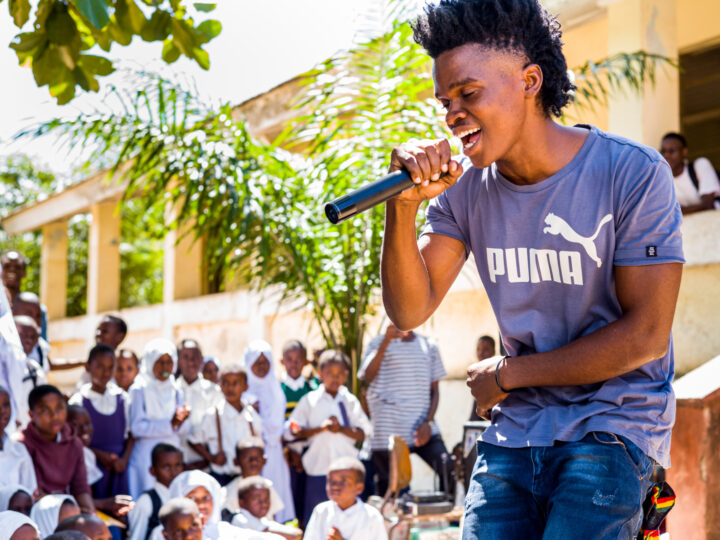 Member of the Youth Group Program singing in a campaign